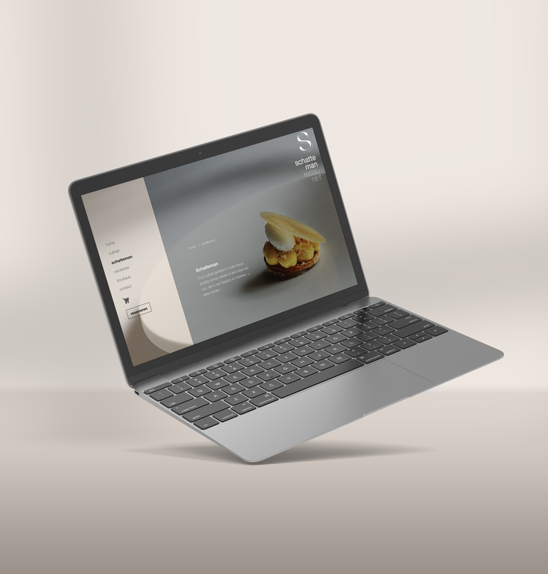 click & collect website van restaurant schatteman op donkere macbook pro
